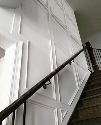 Stair Railing and Paneled Walls